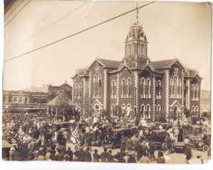 An estimated 5000 citizens gathered at the Hunt County Courthouse in Greenville, Texas on April 21, 1917.  Instead of traditionally celebrating San Jacinto Day, when Texas won her independence from Mexico, the crowd eagerly listened to Governor James Ferguson and showed support for President Wilson's war tactics.  Note the enormous American flag on the flagpole atop the copula.