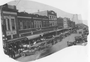 Lee Street on a Saturday afternoon in the summer of 1925.  Everyone came to town to visit, to shop, and make a few trades.  Notice the IOOF Building at the far right.   The Greenville National Exchange Bank would soon move to the opposite corner. (Photo courtesy of author.)